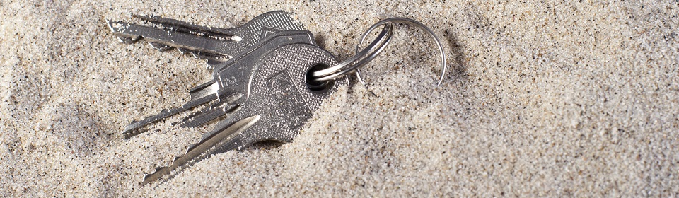 sleutelbos in het zand